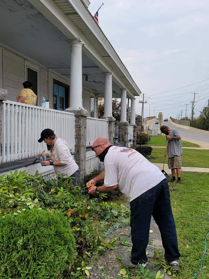 Volunteers trimmed the bushes at Mary Randall Center