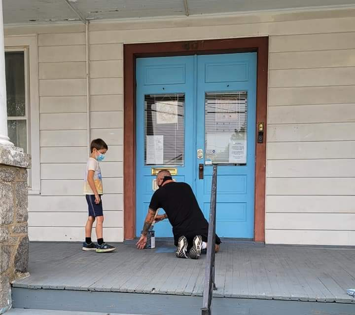 Volunteers painted the porch