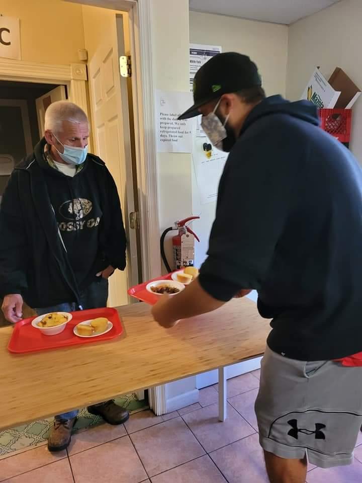 Volunteers served food at Meeting Ground